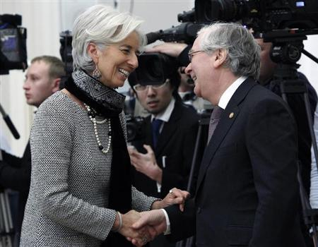 International Monetary Fund chief Christine Lagarde (L) speaks with Mervyn King, the Governor of the Bank of England, during a meeting of G20 representatives with Russian President Vladimir Putin in the Kremlin February 15, 2013. REUTERS/Maxim Shemetov