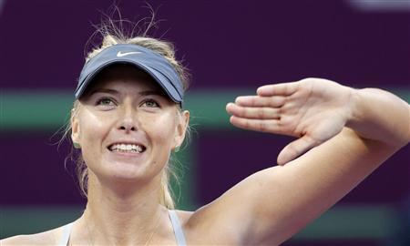 Maria Sharapova of Russia reacts after defeating Samantha Stosur of Australia during their women's quarter-final match at the Qatar Open tennis tournament in Doha February 15, 2013. REUTERS/Fadi Al-Assaad