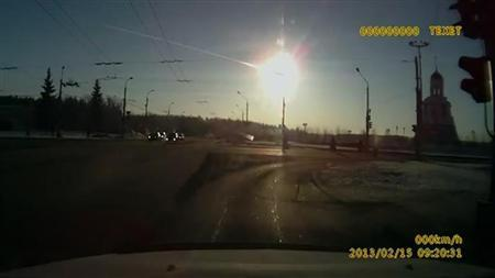 Trail of a meteorite crossing the early morning sky above the city of Kamensk-Uralsky February 15, 2013, is seen in this still image taken from video footage from a dashboard journey recorder and obtained by REUTERS TV. REUTERS/Amateur video via Reuters TV (RUSSIA - Tags: DISASTER ENVIRONMENT TPX IMAGES OF THE DAY) - RTR3DTR6