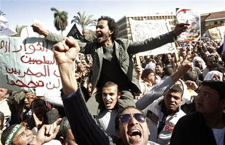 Demonstrators, who support the Islamic Jama'a and the Muslim Brotherhood, chant slogans in support of Egypt's President Mohamed Mursi and the Islamic Shari'a around al-Nahda Square in front of Cairo University in Cairo February 15, 2013. REUTERS/Mohamed Abd El Ghany