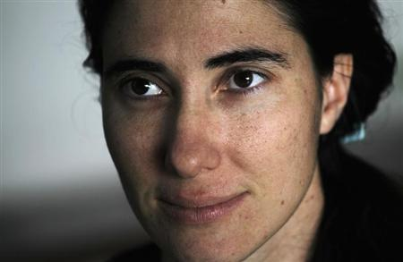 Cuban dissident blogger Yoani Sanchez listens to a question during an interview with Reuters at her home in Havana, in this February 9, 2011 file photo. REUTERS/Desmond Boylan/Files