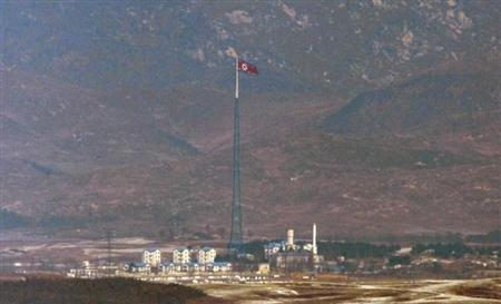 A North Korean flag on a tower flutters in the wind at a North Korean village near the truce village of Panmunjom in the demilitarized zone separating the two Koreas in this picture taken just south of the border, in Paju, north of Seoul, February 15, 2013. REUTERS/Lee Jae-Won