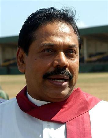 Sri Lankan Prime Minister Mahinda Rajapaksa speaks on the way to his first election rally in Colombo, Sri Lanka August 26, 2005. REUTERS/Prime Minister Media Unite/Handout