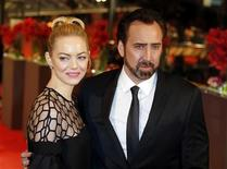"Actors Nicolas Cage and Emma Stone arrive on the red carpet for the screening of the movie ""The Croods"" at the 63rd Berlinale International Film Festival in Berlin February 15, 2013. REUTERS/Tobias Schwarz"