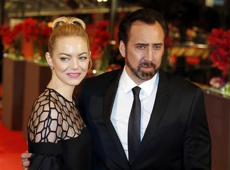 Actors Nicolas Cage and Emma Stone arrive on the red carpet for the screening of the movie ''The Croods'' at the 63rd Berlinale International Film Festival in Berlin February 15, 2013. REUTERS/Tobias Schwarz