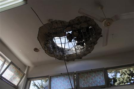 An opening in the ceiling of a room caused by shelling is seen at a building where patients of lbn Khaldoun psychiatric hospital were transferred to, in Aleppo February 14, 2013. REUTERS/Muzaffar Salman
