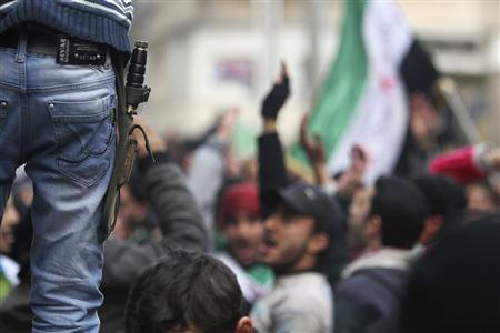 A boy with a knife strapped to his belt attends a protest against Syria's President Bashar al-Assad in the Bustan al-Qasr district in Aleppo February 15, 2013. REUTERS/Muzaffar Salman