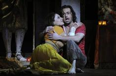 "Hanan Alattar (L), who portrays Leila, and Alfie Boe, who portrays Nadir, perform during a dress rehearsal for the production of Georges Bizet's ""The Pearl Fishers"" at the English National Opera in London May 28, 2010. REUTERS/Dylan Martinez"