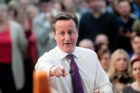 Britain's Prime Minister David Cameron addresses an audience at the headquarters of the B&Q home improvement store in Eastleigh, southern England February 14, 2013. REUTERS/Ben Gurr/Pool