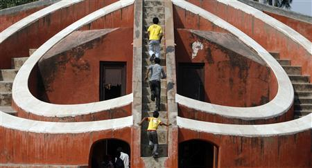 Children play inside one of the instruments of Jantar Mantar, a collection of architectural astronomical instruments, in New Delhi September 29, 2009. REUTERS/Parth Sanyal