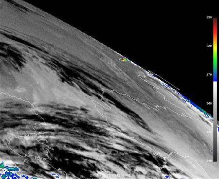 A handout infra-red image taken by EUMETSAT Meteosat-9 geostationary satellite shows the thermal impact of the meteor that was seen near Chelyabinsk in Russia February 15, 2013. REUTERS/Copyright 2013 EUMETSAT/Handout