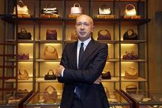 Marco Bizzari, directeur général de Bottega Veneta. La perle ultra-luxe du groupe PPR, qui a vu ses ventes bondir de 38,5% en 2012 à 945 millions d'euros, veut accroître son réseau de magasins de 10% à 15% dans les années à venir et continuer d'investir en Europe autant que dans les pays émergents /Photo prise le 14 février 2013/REUTERS/Charles Platiau