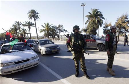 Libyan security forces man a checkpoint on the outskirts of Tripoli February 15, 2013. REUTERS/Ismail Zitouny