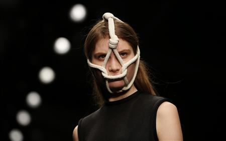 A model presents a creation from the Central Saint Martins Autumn/Winter 2013 collection during London Fashion Week, February 15, 2013. REUTERS/Eddie Keogh
