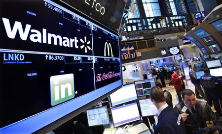 A board shows stock prices for Wal-Mart at the booth they are traded on the floor of the New York Stock Exchange, in this March 6, 2012 file photo. Shares of Wal-Mart Stores Inc fell 3 percent on Friday after Bloomberg quoted a mid-level executive's email as saying the world's largest retailer had the worst sales start to any month in seven years in February. REUTERS/Brendan McDermid/Files