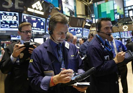 Traders work on the floor of the New York Stock Exchange, February 15, 2013. REUTERS/Brendan McDermid