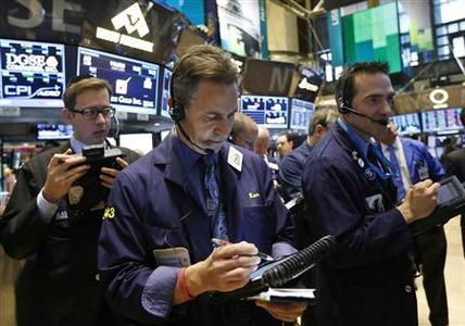 Traders work on the floor of the New York Stock Exchange, February 15, 2013. REUTERS/Brendan McDermid