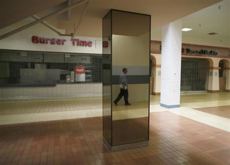 A man walks past empty stores in the deserted Carousel shopping mall in San Bernardino, California September 11, 2012. REUTERS/Lucy Nicholson
