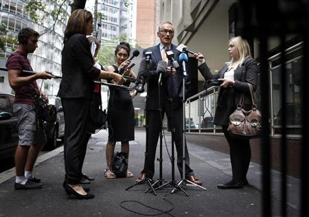Australia's Foreign Minister Bob Carr speaks to the media on a footpath outside his Sydney office, February 16, 2013, regarding Australian independent Senator Nick Xenophon being detained by Malaysian authorities at a Kuala Lumpur airport. REUTERS/Daniel Munoz