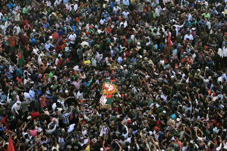 People attend a mass funeral as the body of Rajib Haider, an architect and blogger who was a key figure in organising demonstrations, arrives at Shahbagh intersection in Dhaka February 16, 2013. REUTERS/Andrew Biraj