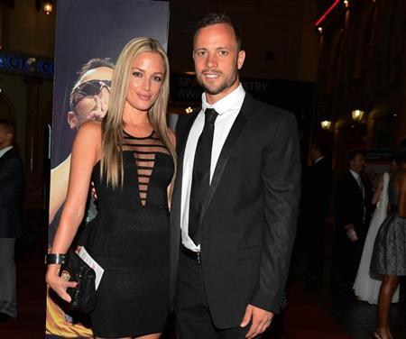 Oscar Pistorius (R) and his girlfriend Reeva Steenkamp pose for a picture in Johannesburg, February 7, 2013. REUTERS/Thembani Makhubele/Files