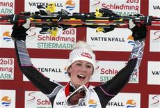 First placed Mikaela Shiffrin of the U.S. reacts on the podium during the flower ceremony after the women's Slalom race at the World Alpine Skiing Championships in Schladming February 16, 2013. REUTERS/Ruben Sprich