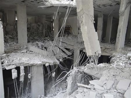 Damage is seen in buildings after what activists say were missiles fired by Syrian Air Force fighter jets operated by forces loyal to Syria's President Bashar al-Assad, in Erbeen, near Damascus, February 14, 2013, in this picture provided by Shaam News Network. REUTERS/Bassam Al-Erbeeni/Shaam News Network/Handout