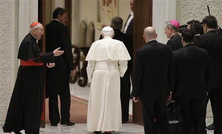 Pope Benedict XVI leaves at the end of a special audience with priests of the Diocese of Rome in Paul VI's hall at the Vatican February 14, 2013. REUTERS/ Max Rossi