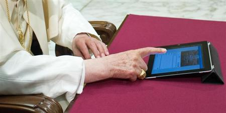 Pope Benedict XVI posts his first tweet using an iPad tablet in Paul VI's Hall at the Vatican December 12, 2012. REUTERS/Osservatore Romano/Files