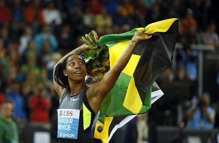 Jamaica's Shelly-Ann Fraser-Pryce celebrates as she won the women's 100m race during the Weltklasse Diamond League meeting in Zurich August 30, 2012. REUTERS/Pascal Lauener