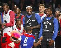 (L-R) NBA All-Stars Kevin Durant (35) of Oklahoma City Thunder, Chris Paul of Los Angeles Clippers, LeBron James (6) of Miami Heat, Blake Griffin of the Clippers and Dwyane Wade of Miami Heat watch a young fan during a dance contest during practice for the NBA All-Star basketball game in Houston, Texas February 16, 2013. The All-Star game will be played on February 17. REUTERS/Jeff Haynes (UNITED STATES - Tags: SPORT BASKETBALL)