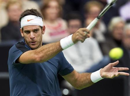 Juan Martin Del Potro of Argentina hits a forehand to Grigor Dimitrov of Bulgaria during their men's singles semi-final tennis match at the World Indoor Tournament in Rotterdam February 16, 2013. REUTERS/Paul Vreeker/United Photos