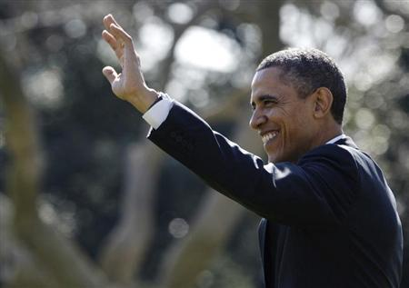 U.S. President Barack Obama waves to visitors as he departs for travel to Chicago and, eventually, a Presidents Day weekend visit in Florida, from the White House in Washington, February 15, 2013. REUTERS/Jonathan Ernst