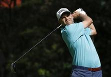 Bill Haas of the U.S. tees off on the 12th hole during the third round of the Northern Trust Open golf tournament at Riviera Country Club in Los Angeles February 16, 2013. REUTERS/Danny Moloshok