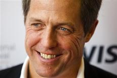 "Actor Hugh Grant arrives on the red carpet for the gala presentation of the film ""Cloud Atlas"" at the 37th Toronto International Film Festival, September 8, 2012. REUTERS/Mark Blinch"