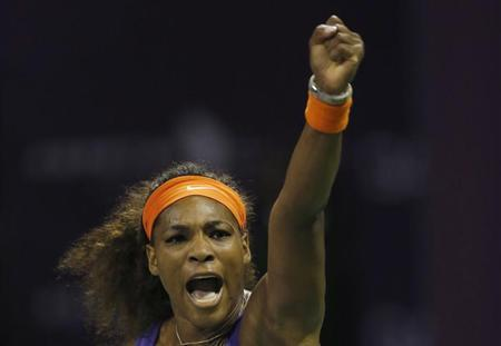 Serena Williams of the U.S. reacts as she celebrates a point against Maria Sharapova of Russia during their women's semi-final match at the Qatar Open tennis tournament in Doha February 16, 2013. REUTERS/Fadi Al-Assaad