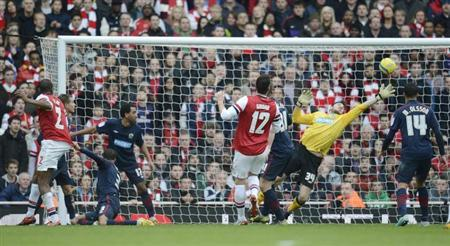 Blackburn Rovers' Jake Kean (2nd R) saves a header by Arsenal's Abou Diaby (L) during their FA Cup soccer match in the Emirates stadium, London February 16, 2013. REUTERS/Philip Brown