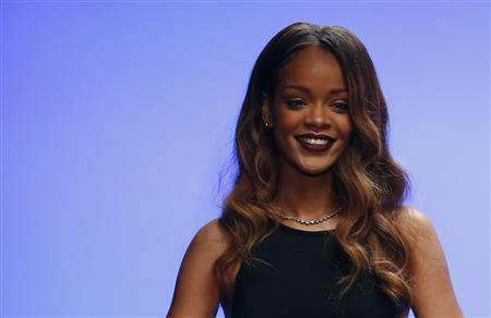 Singer Rihanna walks out onto the catwalk after the presentation of her Rihanna for River Island Autumn/Winter 2013 collection during London Fashion Week, February 16, 2013. REUTERS/Suzanne Plunkett (BRITAIN - Tags: FASHION ENTERTAINMENT)