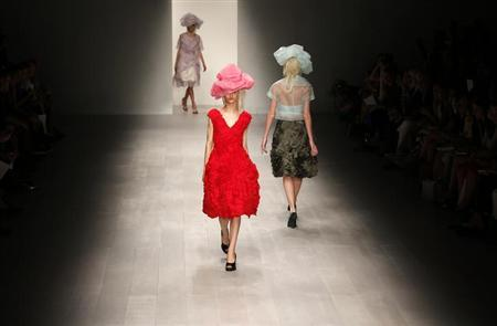 Models present creations from the John Rocha Spring/Summer 2013 collection at London Fashion Week September 15, 2012. REUTERS/Olivia Harris