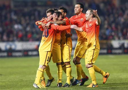 L-R) Barcelona's Lionel Messi celebrates his goal with teammates Pedro Rodriguez, Thiago Alcantara, Sergio Busquets and Andres Iniesta during their Spanish first division soccer match against Granada at Los Carmenes stadium in Granada February 16, 2013. It was his 300th goal for Barcelona. REUTERS/Pepe Marin