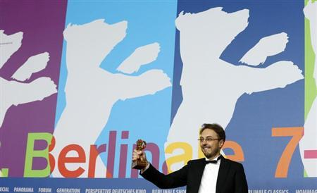 Director Calin Peter Netzer holds the Golden Bear award he received for the Best Film for ''Pozitia Copilului'' (Child's Pose) at the 63rd Berlinale International Film Festival in Berlin February 16, 2013. REUTERS/Tobias Schwarz