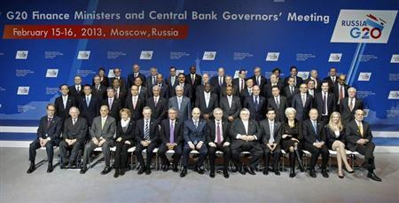 Finance ministers and central bank governors pose for a family photo during a meeting of G20 finance ministers and central bank governors at the Manezh Exhibition Center in Moscow February 16, 2013. The Group of 20 nations declared on Saturday there would be no 'currency war' and deferred plans to set new debt-cutting targets in an indication of concern about the fragile state of the world economy. REUTERS/Sergei Karpukhin (RUSSIA - Tags: POLITICS BUSINESS)