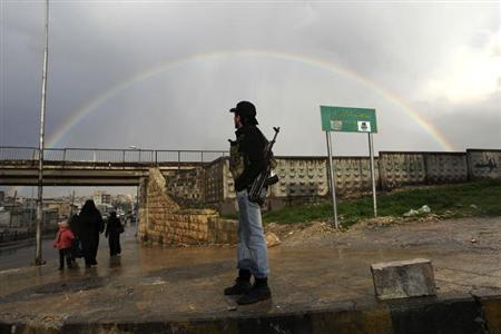 A member of the Free Syrian Army stands with his weapon as he looks at a rainbow in Aleppo February 16, 2013. REUTERS/Muzaffar Salman (SYRIA - Tags: CONFLICT POLITICS CIVIL UNREST TPX IMAGES OF THE DAY)