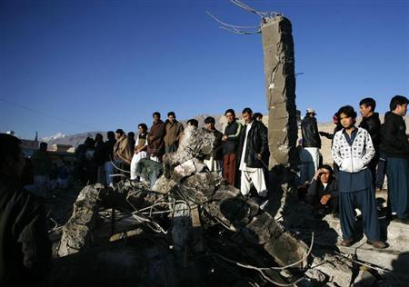 People inspect the site of Saturday's bomb attack in a Shi'ite Muslim area in the Pakistani city of Quetta February 17, 2013. A provincial official criticized Pakistani security forces on Sunday after a bombing targeting the Shi'ite Hazara community killed 80 people in the northwestern city of Quetta. REUTERS/Naseer Ahmed (PAKISTAN - Tags: CIVIL UNREST CRIME LAW POLITICS RELIGION)