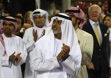 Sheikh Nahayan bin Mubarak al-Nahayan applauds the top three riders during the prize-giving ceremony of the Global Champions Tour 2011 at the Grand Prix of Abu Dhabi November 26, 2011. REUTERS/Martin Dokoupil