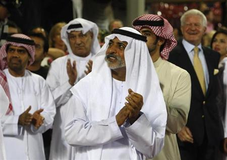 Sheikh Nahayan bin Mubarak al-Nahayan applauds the top three riders during the prize-giving ceremony of the Global Champions Tour 2011 at the Grand Prix of Abu Dhabi November 26, 2011. REUTERS/Martin Dokoupil/Files