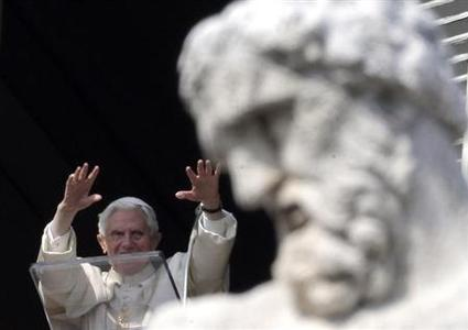 Pope Benedict XVI waves as he leads the Sunday Angelus prayer in Saint Peter's Square at the Vatican February 17, 2013. Thousands of people are gathered in St. Peter's Square for the Sunday Angelus prayer. REUTERS/Max Rossi (