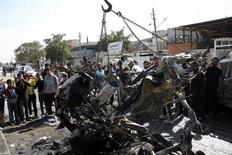 Residents gather at the site of a car bomb explosion in Sadr City, northeastern Baghdad February 17, 2013. A series of car bombs exploded in mainly Shi'ite neighbourhoods across the Iraqi capital Baghdad on Sunday, killing at least 20 people and wounding dozens, police and hospital sources said. REUTERS/Wissm al-Okili (IRAQ – Tags - Tags: CIVIL UNREST)