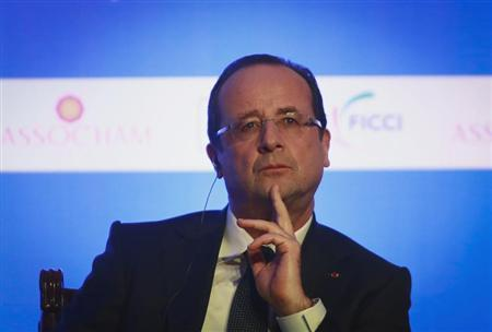 France's President Francois Hollande attends the India-France Economic Conference in Mumbai February 15, 2013. Hollande is on a two-day state visit to India. REUTERS/Danish Siddiquil