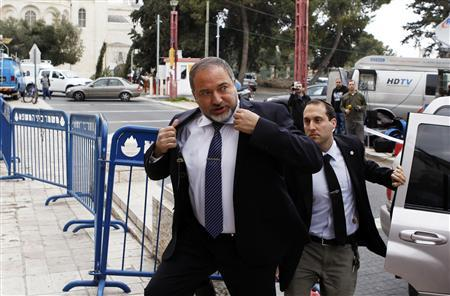 Avigdor Lieberman (C), former Israeli foreign minister, arrives at Jerusalem's magistrate court February 17, 2013. Lieberman's trial began in Jerusalem on Sunday and he pleaded not guilty to charges of fraud and breach of trust, allegations that prompted his resignation as foreign minister in December. REUTERS/Baz Ratner